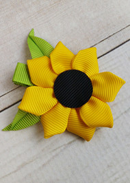 Sunflower grosgrain ribbon hair clip with alligator clip backing.