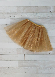"Gold tulle tutu with a metallic gold ""splatter."" The waist is a stretchy satin lined material to fit a wide age range and the tulle skirt is about 11.""  Available in one size only, this tutu fits most kids between 2-8 years."