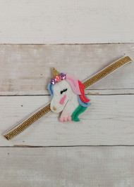 Felt rainbow unicorn accent on gold glitter elastic headband. One size fits most girls.