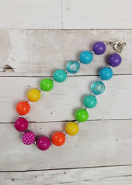 "Chunky bead necklace in bright rainbow colors with heart clasp. Approximately 17""."