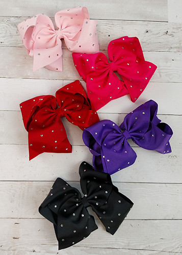 """Texas size hair bows sprinkled with rhinestone embellishments! With 3"""" grosgrain ribbon, each bow measures about 7-8"""" across. These bows include a toothed style alligator clip to securely attach them."""