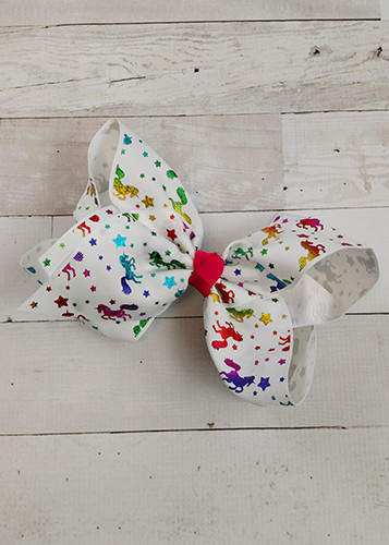 "Rainbow glitter unicorn pattern on a white bow with hot pink center accent! With 3"" grosgrain ribbon, each bow measures about 7-8"" across. These bows include a toothed style alligator clip to securely attach them."