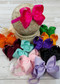 Classic oversized hair bow on a satin headband. Satin headbands are 18cm laying flat and stretch to fit a wide age range. Most headbands match the bow color, some are black or white; please see photos.