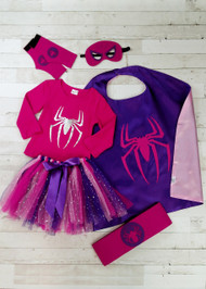 Pink & purple Spider Girl costume set includes: Long sleeve tee, tutu, felt belt, felt cuffs, felt mask, and cape. Perfect for a super girl's Halloween!
