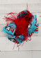 "A large double looped grosgrain ribbon hair bow in turquoise cat in the hat print with a red ostrich feather puff the center.  Attaches with a large 3"" alligator clip with ""teeth"" for a secure hold.  The bow measures approximately 6.5"" long and 5"" wide."