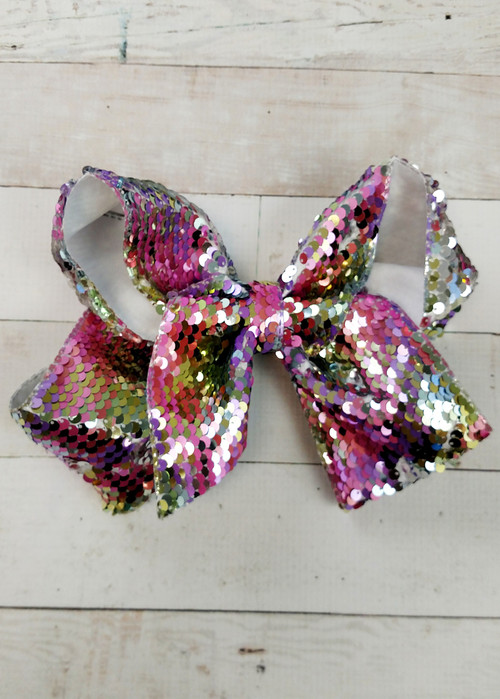 "Love big bows and sequins?! Our Pastel Rainbow Reversible Sequin Texas Size Hair Bow is big, colorful, and fun with it's trendy reversible sequins. With 3"" sequin ribbon, each bow measures about 7-8"" across. These bows include a toothed style alligator clip to securely attach them. These big sequin bows are great!     The size of these bow may cause them to get a little 'smooshed' by their packaging. We recommend fluffing them up by hand."