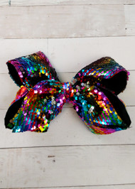 "Love big bows and sequins?! Our Rainbow Reversible Sequin Texas Size Hair Bow is big, colorful, and fun with it's trendy reversible sequins. With 3"" sequin ribbon, each bow measures about 7-8"" across. These bows include a toothed style alligator clip to securely attach them. These big sequin bows are great!     The size of these bow may cause them to get a little 'smooshed' by their packaging. We recommend fluffing them up by hand."