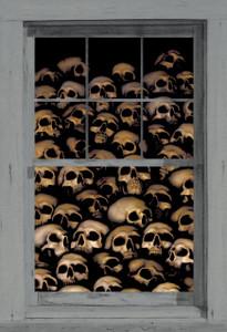 decorative halloween poster of skulls shown in a window