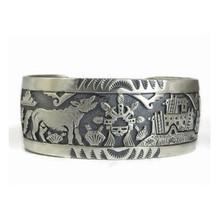Sterling Silver Wolf, Sun Face & Adobe Dwelling Bracelet by Freddy Charley, Navajo