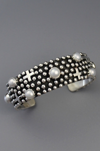 Sterling silver cuff bracelet with pearls and crosses by Navajo artist, Happy Piaso.
