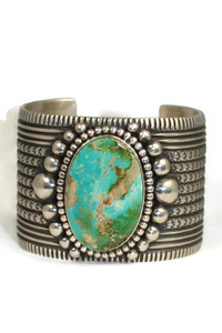 "Front view of Pilot Mountain turquoise cuff bracelet by Guy Hoskie. The bracelet is 1 3/4"" wide with a large natural turquoise gem."