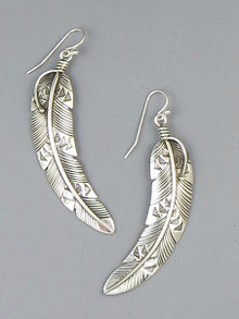 Long silver feather earrings by Lambert Perry.