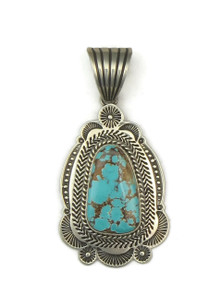 Front view of natural brown webbed Pilot Mountain turquoise pendant by Navajo artist, Albert Jake.
