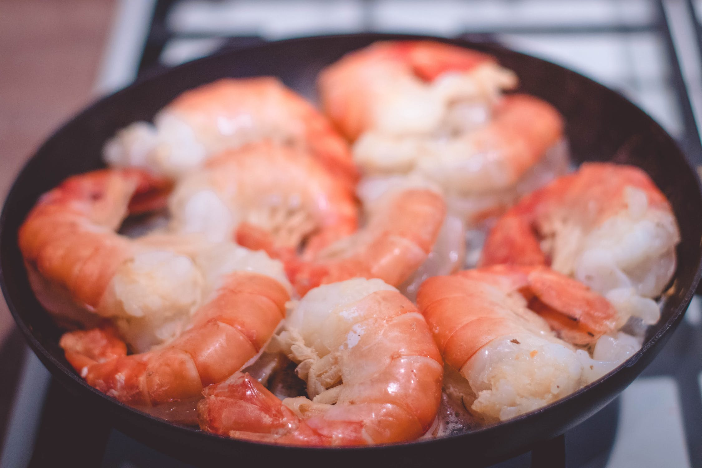 Several shrimp in a small skillet