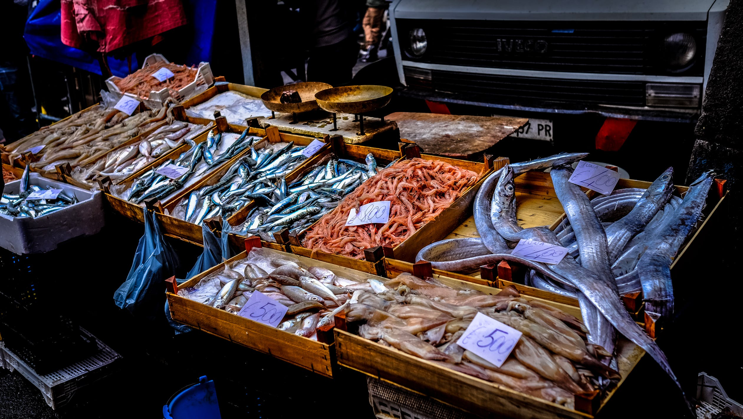 A market stall offering a variety of fresh raw seafood