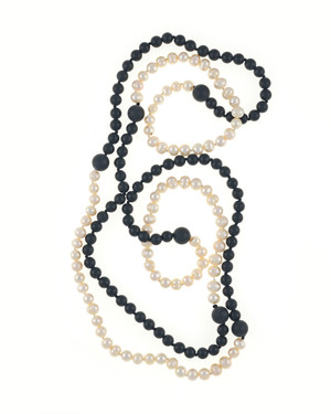 Copacabana Promenade I - Pearl Necklace Accented with Onyx, Single strand white freshwater pearls 7.5mm, transitioning to untumbled onyx beads 8mm, punctuated with 14mm untumbled onyx beads, on individually hand knotted natural silk