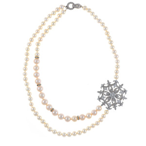 "Mont Blanc Pearl Necklace: Partial double strand white freshwater pearls 7-9.5mm, handset CZs in stainless steel offset  brooch, on individually hand-knotted white silk, sterling silver clasp, 18"" in length, princess length."