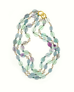 Seychelles pearl and gemstone triple strand necklace: Multi-strand, white 7.5mm freshwater pearls, fluorite beads and jade, separated with natural turquoise beads and gold colored glass beads, on individually hand-knotted beige silk with a mixed metal goldtone hook clasp