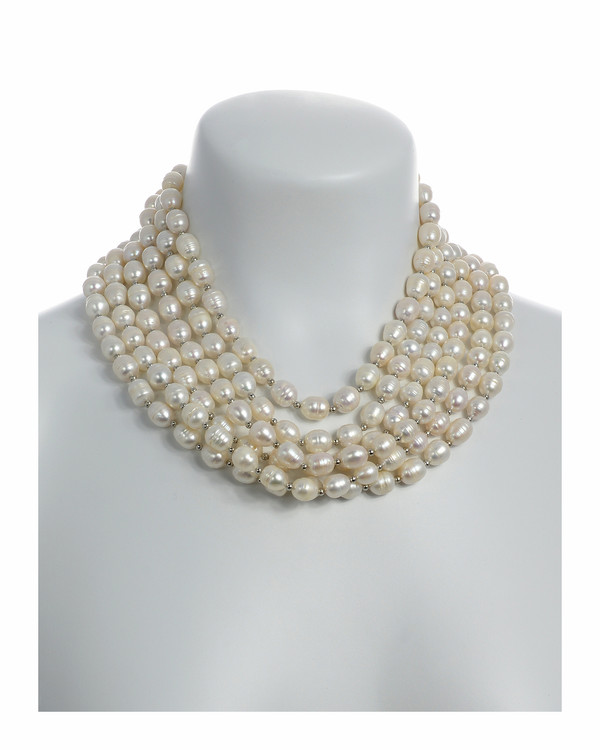 Beauchamp Place - Pearl Necklace On Model: 6 strand, freshwater white rice pearls 9.5-10.5mm, interspaced with silver color beads, on individually hand-knotted natural silk with silver metal lobster claw and jump chain.