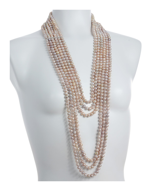 "Bonaire - Pearl Necklace On model: six strand, natural pink freshwater pearls 7.5-8mm, with silver spacer bars(1.5""), handset with CZs, on individually hand-knotted natural silk,  strands vary from 28"" to 42"" in length"