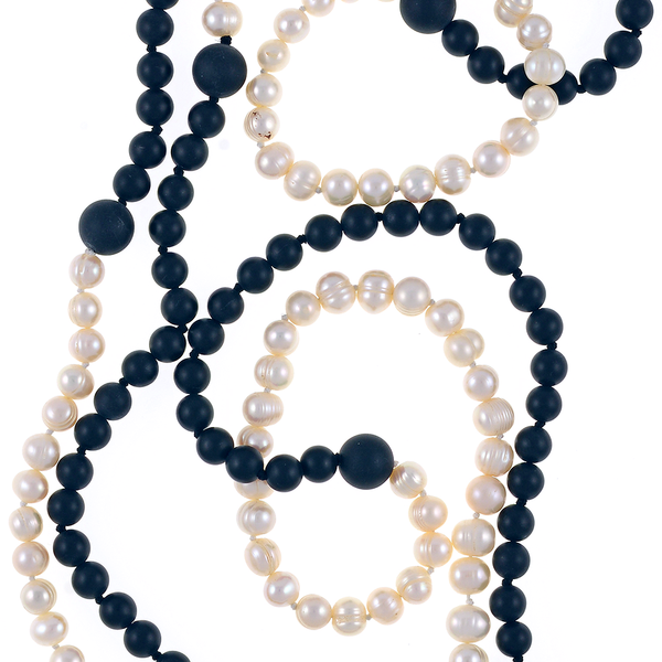 Copacabana Promenade I - Pearl Necklace Accented with Onyx, Zoom: Single strand white freshwater pearls 7.5mm, transitioning to untumbled onyx beads 8mm, punctuated with 14mm untumbled onyx beads, on individually hand knotted natural silk