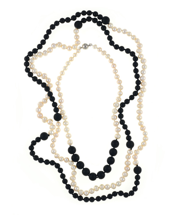 Copacabana Promenade Pearl Necklaces - Pearl Necklace with Onyx: Image 3, composite of Copacabana II and Copacabana I, Single strand graduated white freshwater pearls 6-10mm, leading to untumbled onyx beads 12mm, on individually hand knotted natural silk, with rare earth mixed metal clasp and Single strand white freshwater pearls 7.5mm, transitioning to untumbled onyx beads 8mm, punctuated with 14mm untumbled onyx beads, on individually hand knotted natural silk.