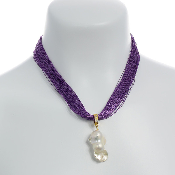 on model, Royal Purple Danxia Silk Necklace paired with Danxia Biawa Pearl Pendant (http://naughtonbraun.com/danxia-pearls-biawa-pearl-pendants/): Colored pure silk (75 strands) gathered together with a rare earth mixed metal magnetic clasp.