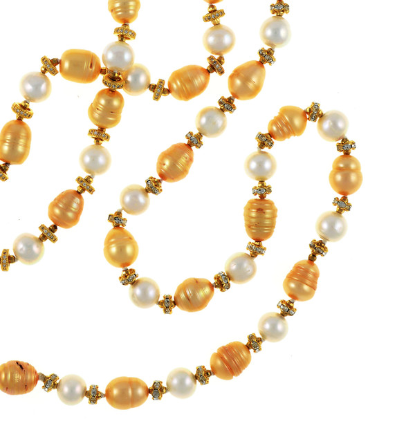 "Pearl necklace, zoom of Leone d'Oro I (http://naughtonbraun.com/leone-doro-i-pearl-necklace/), top left of image and Leone d'Oro II, right side of image Single strand freshwater white 9mm and gold 10.5x13mm laser dyed gold pearls, Leone d'Oro II is longer, 30"", rope or lariat length"