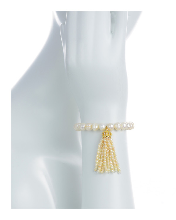 "Little Gold Crown - Pearl Bracelet on model: Single strand beaded pearl bracelet with white freshwater pearls 9-10mm,1.5"" seed pearl tassel drop suspended from mixed metal gold crown, on elastic, one size"