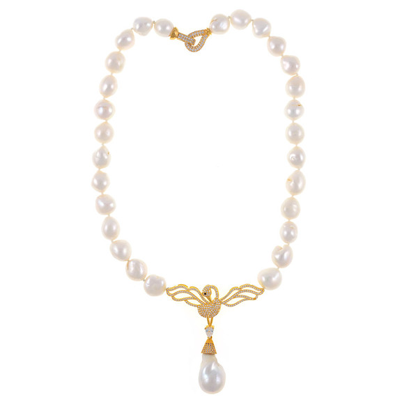 "Odette Anthology* - Pearl Necklace, Odette Gold-tone: Single strand white potato pearls 13-14mm, 7cm CZ gold-tone swan pendant with biawa 18-19mm, CZ covered gold-tone mixed metal locking circle clasp, 18"" in length, princess length"