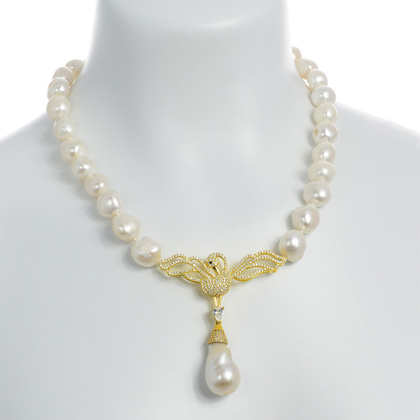 "Odette Anthology* - Pearl Necklace on model, Odette Gold-tone: Single strand white potato pearls 13-14mm, 7cm CZ gold-tone swan pendant with biawa 18-19mm, CZ covered gold-tone mixed metal locking circle clasp, 18"" in length, princess length"