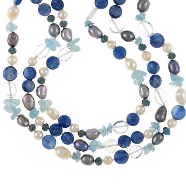 "zoom of Santorini necklace accented with stones : Triple strand white 7mm round freshwater pearls, white 9x11mm and grey 8x10mm baroque freshwater pearls, crystal quartz, indigo, kyanite, and aquamarine, on individually hand-knotted natural silk with a rare earth mixed metal magnetic clasp, 18"" in length (princess length)"