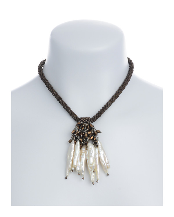 "The Luray Treasury* Pearl Necklace on model in Taupe: Hand-woven taupe matte hematite bead necklace with 8 dangling freshwater tooth pearls and matching polished hematite beads, with rare earth mixed metal magnetic clasp, 17"" length with 2.5"" tooth pearl drop."
