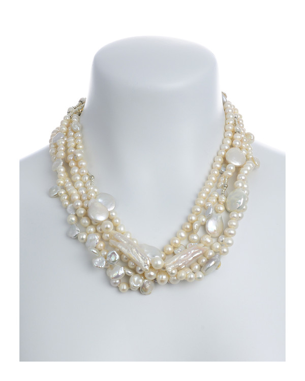 "on model, White Cliffs Pearl necklace: 5 strands of mixed sized seed pearls mixed with freshwater pearls, keshi, coin, and stick pearls, and dotted with glass beads,individually hand-knotted on silk, featuring a mixed metal leaf toggle clasp, 18"" in length (princess length)"