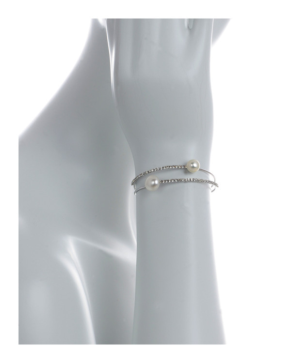 on model, Rockefeller Center Pearl bracelet: Double stranded mixed metal cuff bracelet featuring 2 freshwater pearls 8mm, with 2 rows of CZ accents, one size.