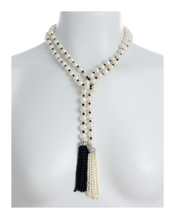 "Salome Pearl necklace necklace with white and black tassel, 9-10mm white round freshwater pearls separated with onyx, individually hand-knotted on silk, on model, can be worn looped as shown, 50"" in length (rope length)"