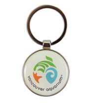 Vancouver Aquarium inspired key ring with a circular decorative piece.