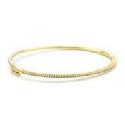 Yellow gold vermeil oval CZ cuff bangle in sterling silver from One by One Jewellery London