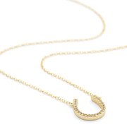 Gold horseshoe necklace channel set czs