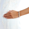 Wrist showing three finishes in rose gold yellow gold and white rhodium of Allobar cuff bangle