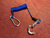 Compact breakaway coiled tie-cable keeps the tie from draping on the ground, away from your horse's feet.