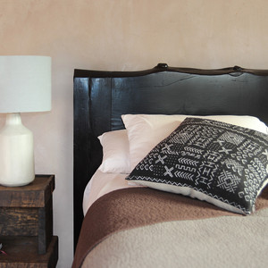 As Shown: Pagosa Live Edge Headboard Size: King Headboard - 84 x 3 x 48 H inches Finish: Ebony Topcoat: Sealed Topcoat