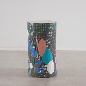 As Shown: La Condesa Hand Painted Side Table Size: 12 dia x 22 H inches Color: Mutli Topcoat: Sealed Topcoat