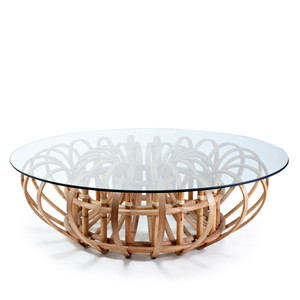 As Shown: Aiden Cocktail Table Size: 54 dia x 16.75 H inches Material: Rattan, Glass
