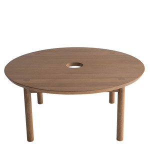 As Shown: Aurea Coffee Table Size: 32 dia x 14 H inches Material: Solid White Oak with Sienna Finish