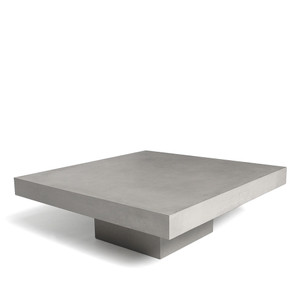 As Shown: Suspend Disbelief Coffee Table Size: 35.5 x 35.5 x 12 H inches Material: Concrete  Description: A slab of concrete floats seamlessly above a recessed base to create a lightness not usually associated with the material. Made by hand, concrete is blended with sand and fiberglass to create a lightweight and durable material. Finished with a waterproof sealer, it is suitable for interior or exterior use. Its perfect proportions and size give it the presence to fill a large space or tuck into a small one - indoor or out.