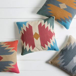 As Shown: Kilim Wings Pillow Size: 18 x 18 inches Material: Cotton  Description: A bold center design modernizes our beautiful Kilim pillows for a blend of old and new. By hand artisans craft each piece using traditional weaving techniques, then back in cotton fabric. Fitted with a feather and down inner, they are available in multiple sizes and colors. You'll love mixing colorways and combining it with our Contemporary Kilim Pillow with Chevron Rows.