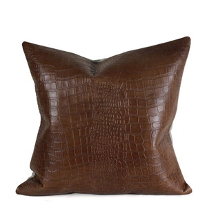 As Shown: Cocodrilo Crocodile Pillow Size: 16 x 16 inches Material: Leather  Color: Tobacco Brown  Description: This classic take on a croc-embossed leather pillow is softened when backed with natural linen, or go for a rich look with a full leather back. It's entirely up to you. Fitted with a feather and down inner, your pillow will be individually hand made for you. We love mixing a few different tones and sizes in a grouping for layered impact.