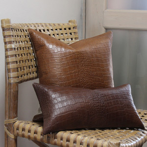 As Shown: Cocodrilo Crocodile Pillow Size: 9 x 18, 18 x 18 inches Material: Leather  Color: Chocolate Brown, Saddle Brown