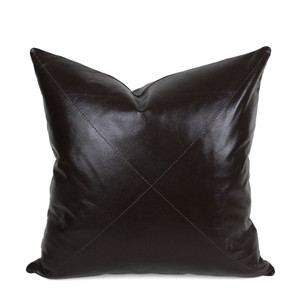 As Shown: Dark Chocolate Leather Pillow Size: 16 x 16 inches Material: Leather Color: Dark Chocolate  Description: This glossy supple piece, available in three styles for your customization, is your go-to classic in soft durable dark chocolate brown napa leather. Throw it anywhere for timeless sophistication. Artisans finish the full-grain sheepskin hide front per your specifications, then back in matching leather. Fitted with a feather and down inner and hidden zipper, your pillow will be individually created for you.